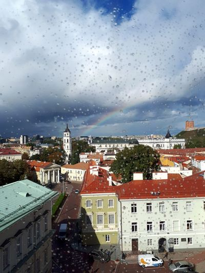 the beauty after the rain VU Vilnius Gediminas Tower Sunlight Rainbow City Cityscape Urban Skyline Water Residential Building Roof House Sky Architecture Storm Cloud Old Town First Eyeem Photo