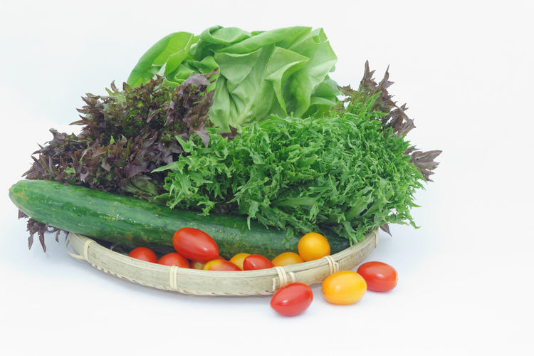 Vegetables on isolated white background Lettuce Salad Romaine Tomato Isolated White Background Isolated Vegetable Vegetarian Food Food Diet Dieting Snack Time! White Background Healthy Lifestyle Herb Studio Shot Vegetable Variation Basil Raw Food Organic Green Color Vegan Cherry Tomato Low Carb Diet Cucumber Zucchini Salad Bowl
