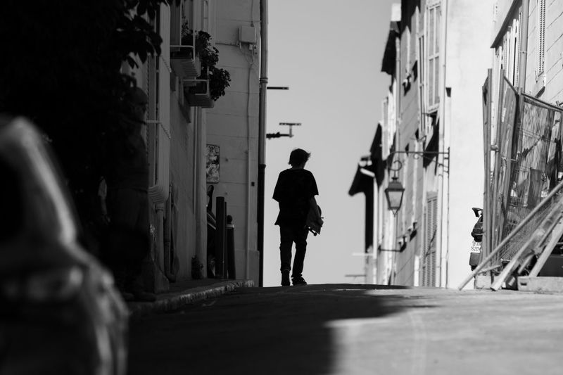 """"""" Before the downhill """" Walking One Person Blackandwhite Light And Shadow Silhouette Cityscapes Getting Inspired Shootermag Eye4photography  EyeEm Best Shots Skateboarding City Life Bnw"""
