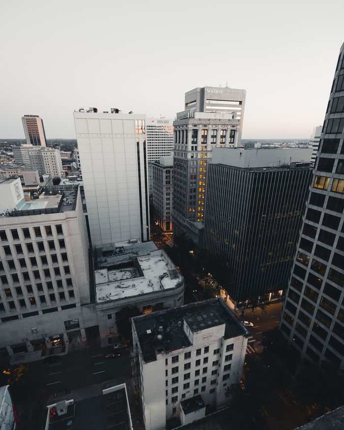 HIGH ANGLE VIEW OF MODERN BUILDINGS AGAINST CLEAR SKY