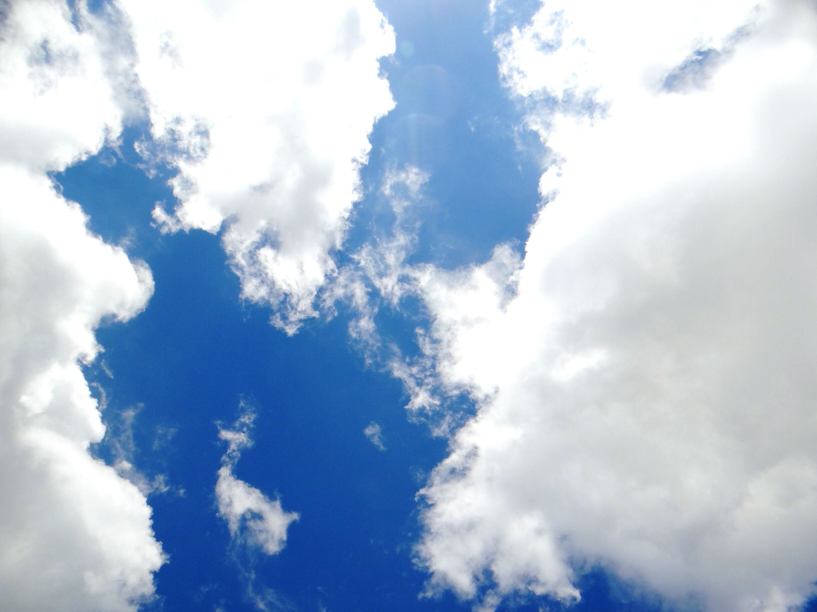 sky, low angle view, cloud - sky, cloudy, sky only, beauty in nature, tranquility, scenics, cloudscape, nature, cloud, blue, tranquil scene, backgrounds, full frame, white color, idyllic, day, outdoors, no people