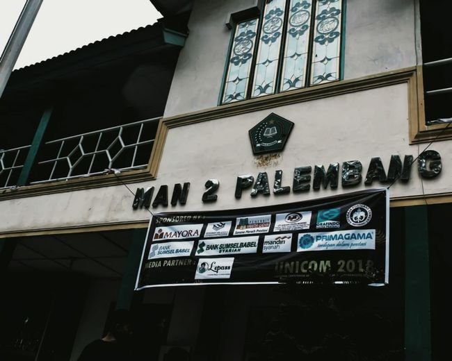 Low angle view of information sign on building