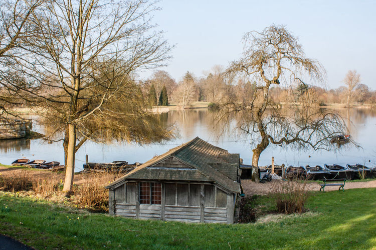 Boating lake and boat house at Hever Castle, Kent Architecture Built Structure Plant Tree Building Exterior Building Grass House Bare Tree Water Landscape Sky Boat House Autumn Autumn colors Lake Lake View Lake House  No Leaves Hever Castle Hever Garden Hever