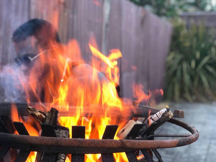 Man by fire