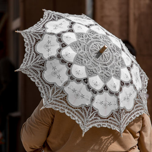 Cropped image of person with umbrella