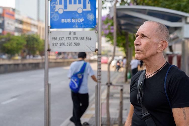 Man standing at bus stop