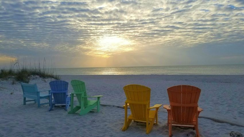Sunset_collection Gulf Of Mexico Colorful Sky Florida Beachphotography Sand Before Sunset Colorful Eye Candy Colors Beach Sea Chair Sand Sunset Water Summer Horizon Over Water Outdoor Chair Relaxation Vacations Nature Tranquility Sun Tranquil Scene Outdoors No People Sunlight Weekend Activities Sky