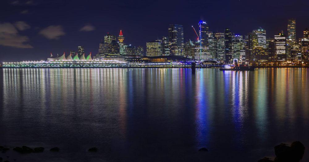 Vancouver skyline by night Vancouver Canada British Columbia Lights Water Reflections City Cityscape Urban Skyline Illuminated Skyscraper Modern Sea Nightlife Multi Colored Celebration
