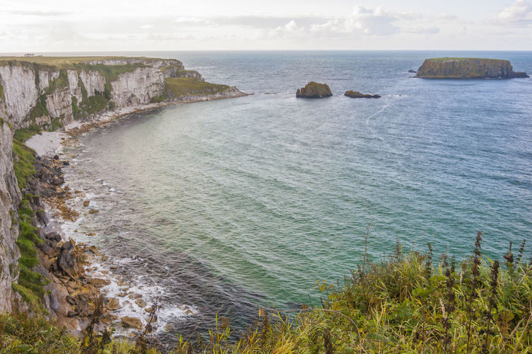 Seascape at The Carrick a rede in Northern Ireland Water Sea Scenics - Nature Beauty In Nature Tranquil Scene Tranquility Rock No People Nature Day Plant Land Rock - Object Sky Grass Horizon Beach Solid Outdoors Horizon Over Water