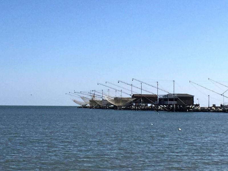 Along The Jetty Fishing Net Outdoors Sea Sky Waterfront