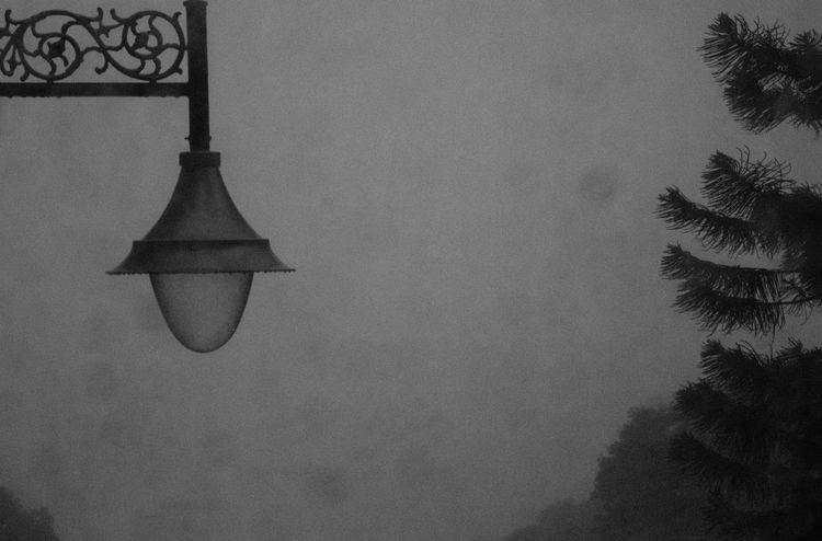 Artistic Lamp Post. Blackandwhite Blackandwhite Photography Dark High Section Illuminated Lamp Lamppost Low Angle View No People Outdoors Rainy Days Scenics Simplicity Sky Street Light Vignette