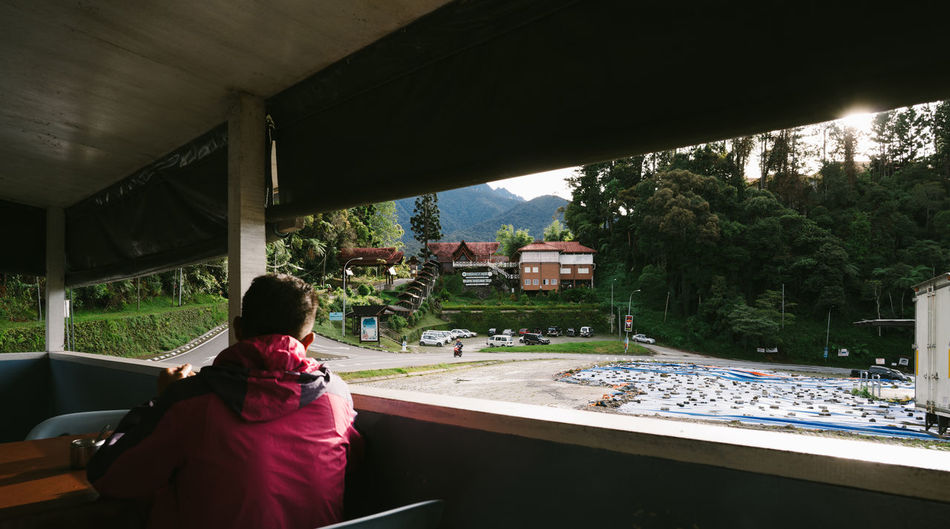 Morning Time at Mt Kinabalu Park Adult Architecture Built Structure Childhood Day Indoors  Leisure Activity Lifestyles Men Nature One Person People Real People Rear View Sitting Standing Tree Water