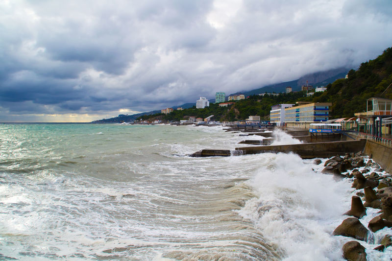 The begining of the storm at the Black Sea in Crimea, Ukraine in October 2013. Four meters waves rising stones from the seabed and threw them up at the hotels windows on the third floor. Waves knocked the door and moved the furniture from room to room. Autumn Colors Beach Clouds And Sky Coastline Crash Crashing Waves  Crimea, Ukraine Horizon Over Water How Do You See Climate Change? Ocean Outdoors Rippled Sand Sea Seascape Storm Storm Clouds Stormy Weather Water Wave Waves Crashing Waves, Ocean, Nature Weather Photography In Motion Landscapes With WhiteWall