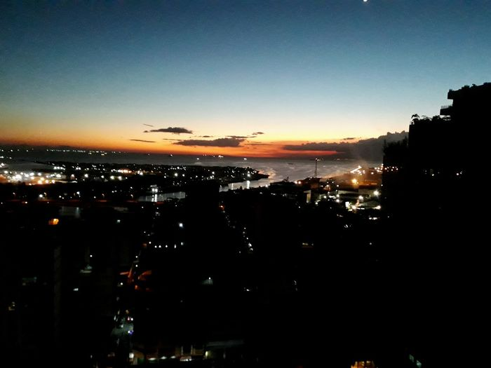 Sunset Illuminated Sky Architecture Skyscraper Downtown Coast Waterfront Horizon Over Water Urban Skyline
