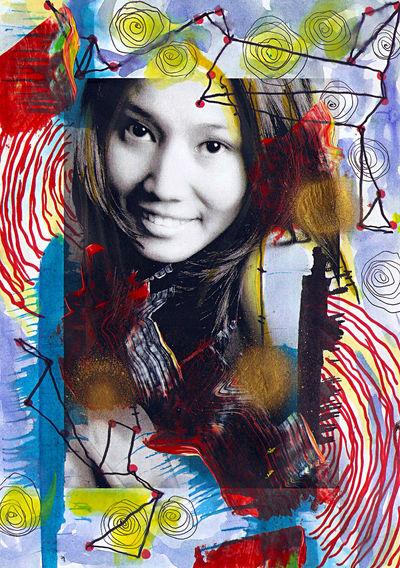 Portrait of woman with multi colored umbrellas