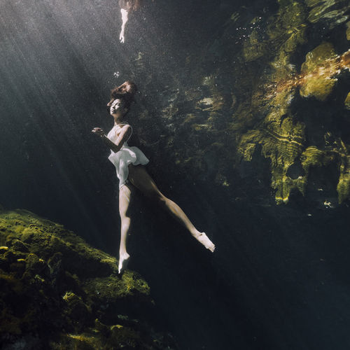Sea Underwater Water Full Length One Person Swimming Nature Side View Young Adult Women Young Women Real People Dancing Leisure Activity Lifestyles Floating Outdoors Human Arm Floating On Water