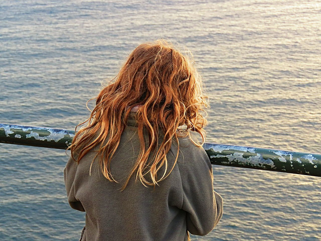 water, rear view, one person, sea, long hair, nature, day, standing, rippled, leisure activity, outdoors, real people, women, one woman only, headshot, blond hair, only women, one young woman only, beauty in nature, young adult, adult, adults only, people