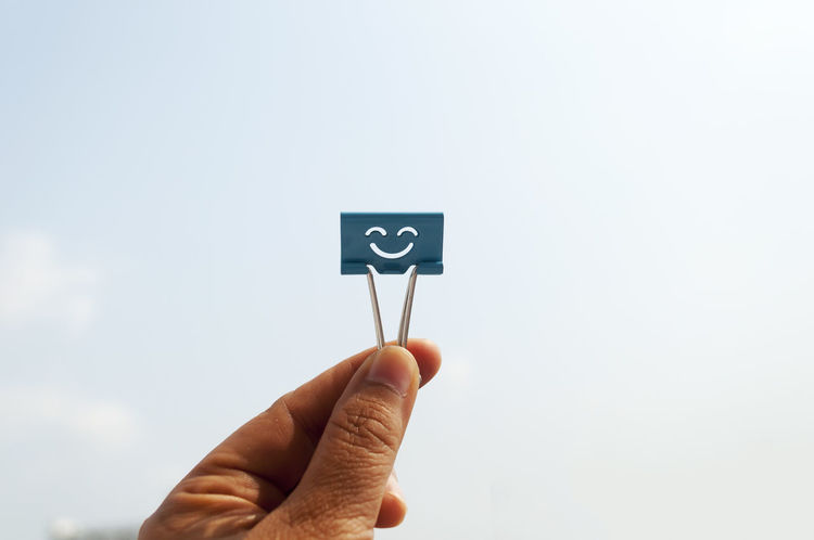 Clipper Emotions Hanging Out Holding Of Paper Clips Person Smile Studio Shot White Background
