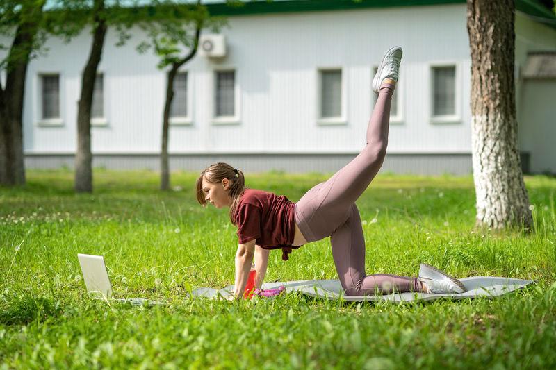 Full length of senior woman in grass