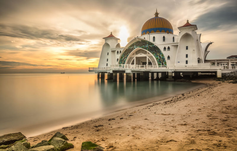 the floating mosque of melaka at sunset Seascape Photography Architecture Belief Building Building Exterior Built Structure Cloud - Sky Cultures Dome Floating Mosque Landmark Malacca Malaysia Masjid Nature No People Outdoors Place Of Worship Religion Seascape Sky Spirituality Sunset Tourism Travel Travel Destinations Water