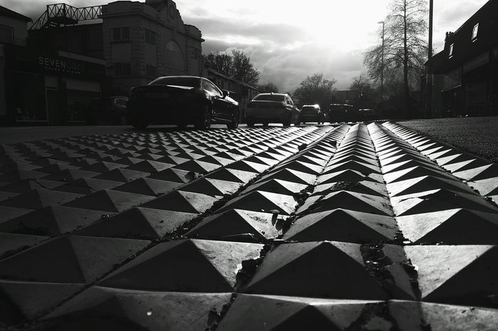 Interesting pyramid spikes by the road Pyramid Leading Lines Textures And Surfaces Shapes And Patterns  Shapes Black And White Roads Showcase March