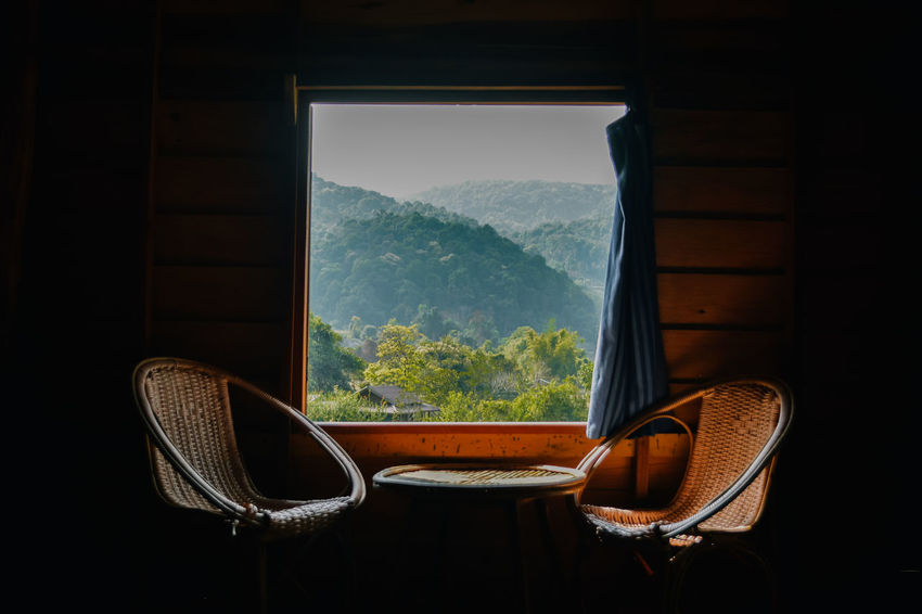 good vibes :) EyeEm Best Shots EyeEm Nature Lover Relaxing Chair Day Enjoying Life Homestay Indoors  Landscape Living Room Mountain Mountain Range Nature No People Photography Rest Seat Slow Life Still Life Table Tree Window Wood - Material