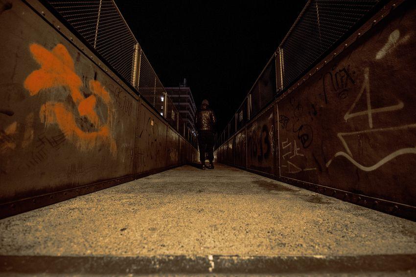 Communism Dark Footbridge Graffiti Low Angle View Rear View Transit Footbridge Crossing Hammer And Sickle Hood Lifestyles Night One Person Passage Real People Street Art Urban