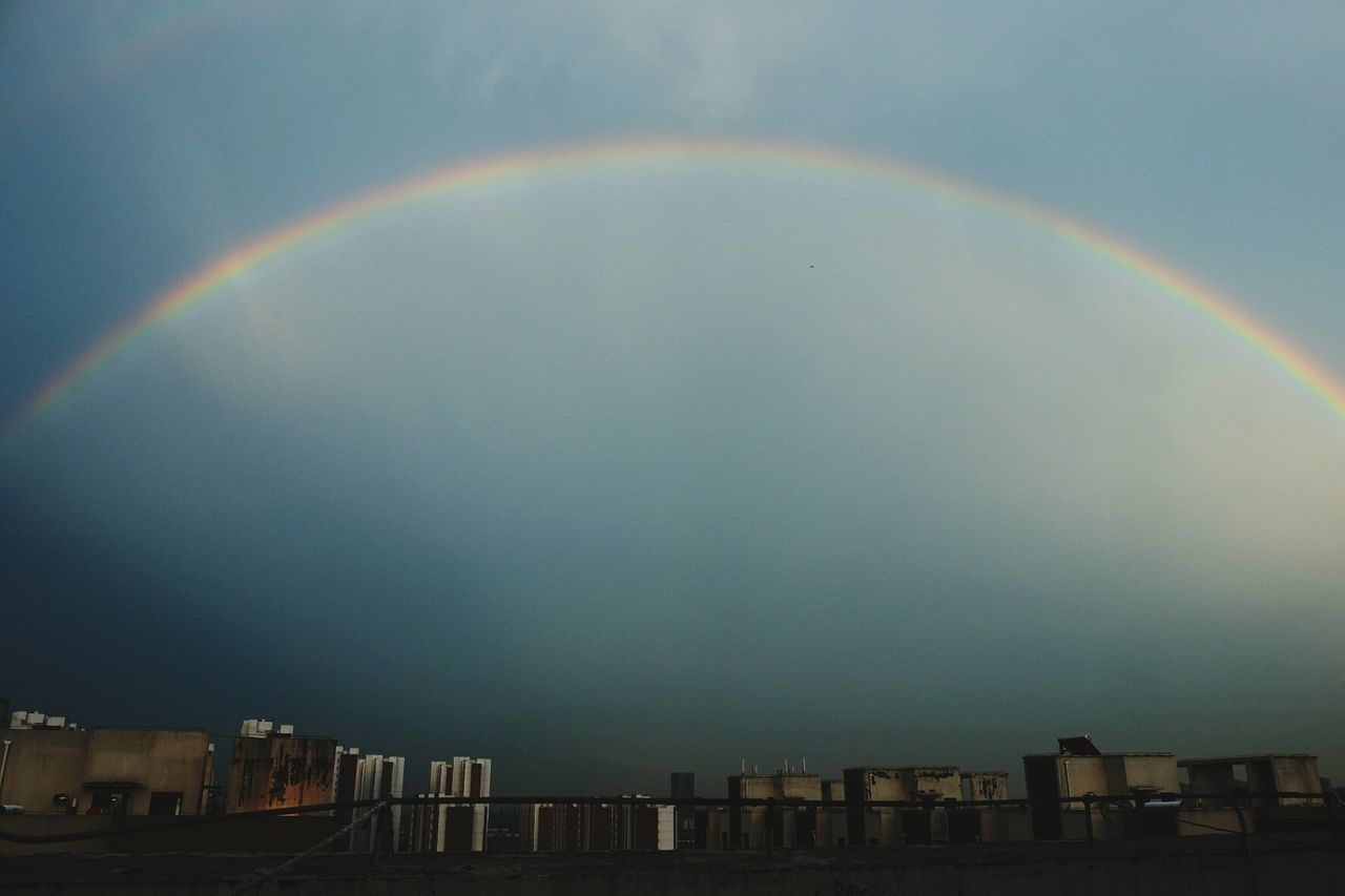 rainbow, double rainbow, building exterior, architecture, built structure, no people, multi colored, outdoors, day, sky, beauty in nature, nature, city, cityscape