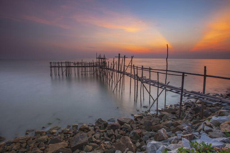 A sunset moment at Sungai Lurus, Batu Pahat, Johor, Malaysia Beach Beauty In Nature Day Fishermen's Life Horizon Over Water Jetty Nature No People Outdoors Pebble Pebble Beach Rock - Object Scenics Sea Sky Sunset Tranquil Scene Tranquility Water