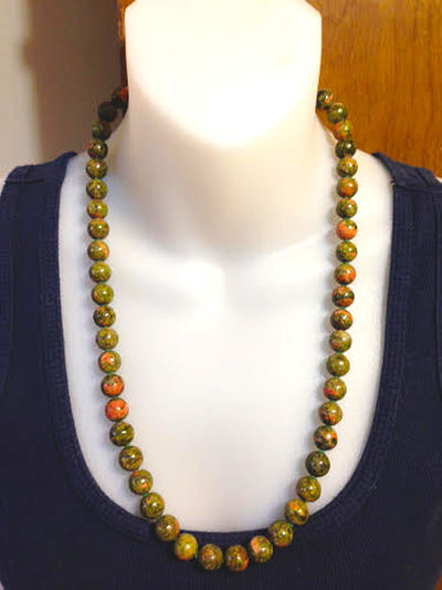 Coordinate your wardrobe with this semi-precious stones. Agate Stone Beauty Close-up Consumerism Elégance Expense Fashion Glamour Gold Colored Indoors  Jewelry Jewelry Store Luxury Necklace Pearl Jewelry Precious Gem Retail  Studio Shot Wealth