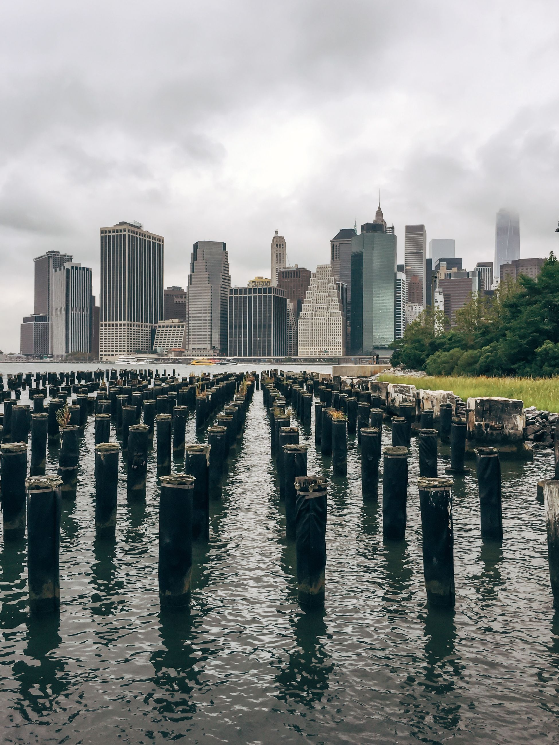 architecture, water, built structure, building exterior, waterfront, sky, reflection, city, river, cloud - sky, in a row, cloudy, skyscraper, day, diminishing perspective, tall - high, modern, outdoors, office building, cloud