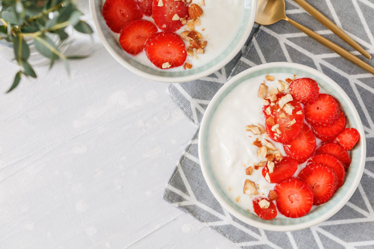 Berry Fruit Bowl Breakfast Dairy Product Eating Utensil Food Food And Drink Freshness Fruit Healthy Eating High Angle View Kitchen Utensil Meal No People Ready-to-eat Red Spoon Still Life Strawberry Table Temptation Wellbeing Yogurt