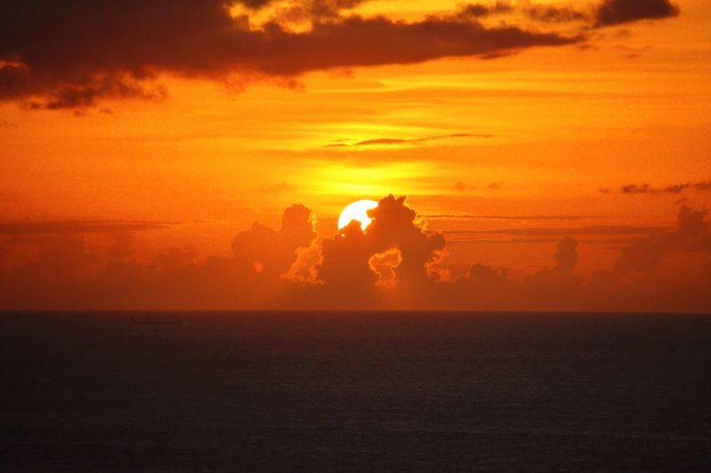 Sunset Sunset Sky Orange Color Beauty In Nature Nature Water Scenics - Nature Sea Cloud - Sky Silhouette Tranquility Tranquil Scene Land Beach Outdoors