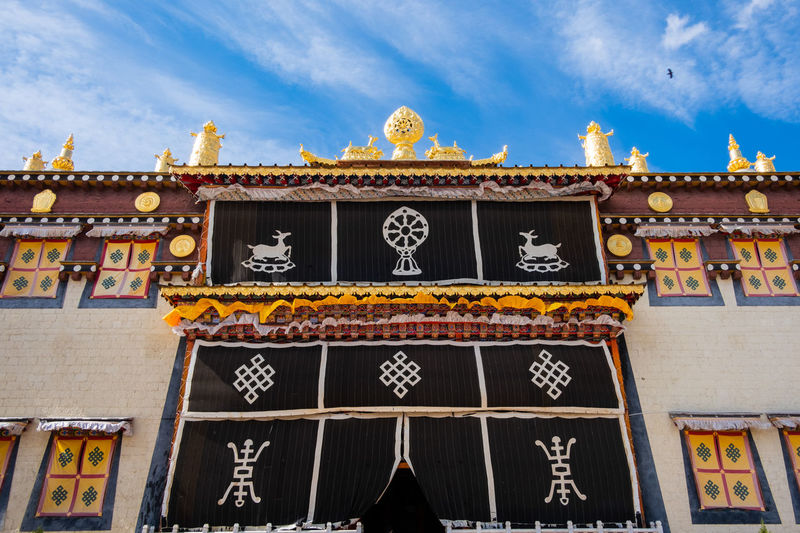 Sky Architecture Building Exterior Built Structure Cloud - Sky Low Angle View Building Day Nature No People Religion Belief Place Of Worship Spirituality Travel Destinations Outdoors Ornate Temple Shangrila Shangri-La Yunnan China Tibet Mountain