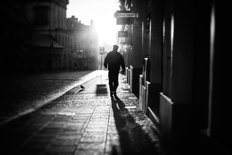 Adult Architecture Black And White Building Exterior Built Structure City Day Discover Your City Dynamic Full Length Light And Shadow Men Monochrome Nikon One Man Only One Person Outdoors People Perspective Real People Rear View Silhouette Sunlight The Week Of Eyeem Walking