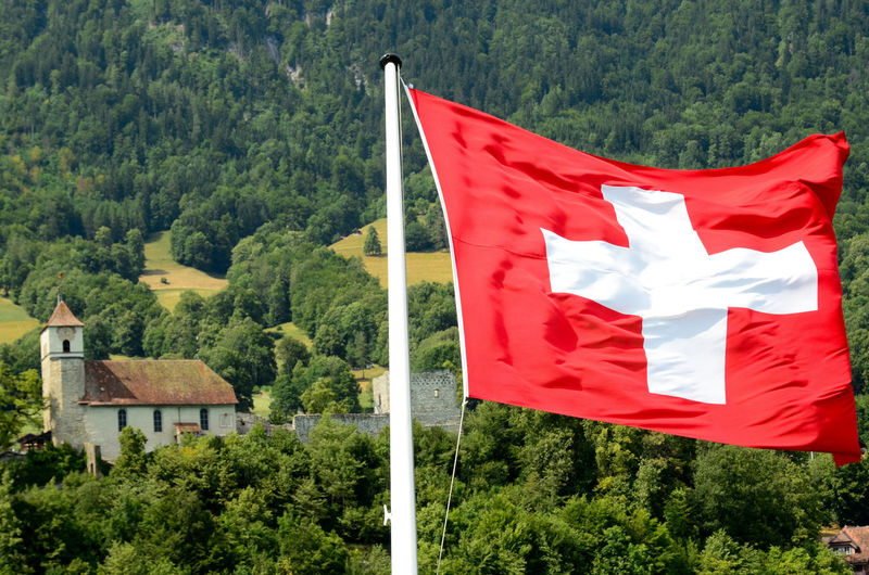 Switzerland Flag Day Flag Green Color Mountain National Flag Nature No People Outdoors Patriotism Red Sky Swiss Flag Tree