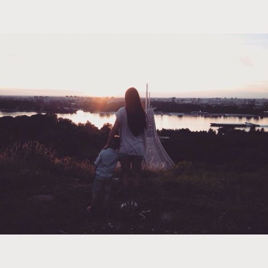 Sunset Women Child Mamasboy Two People Rear View Love Togetherness Lifestyles Water Clear Sky River River View Enjoying The View