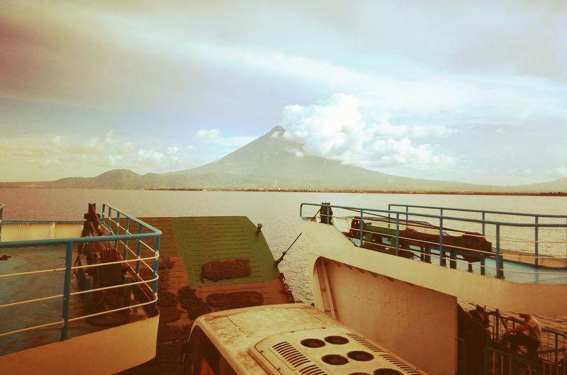 A view of Mayon Volcano, Tabaco City. EyeEmNewHere Eyeemnaturelover EyeemPhilippines The Traveler - 2018 EyeEm Awards Vulcano Mayon Volcano Philippines Water Sea Mountain Railing Sky The Great Outdoors - 2018 EyeEm Awards