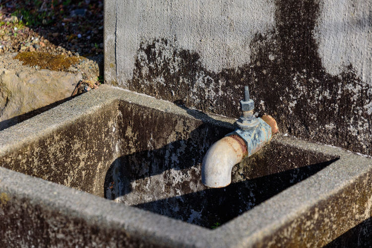 Day Water Outdoors Nature Motion Architecture Construction Industry People Wall - Building Feature Pipe - Tube Built Structure Shadow Construction Site Building Exterior Selective Focus Sunlight Faucet Equipment