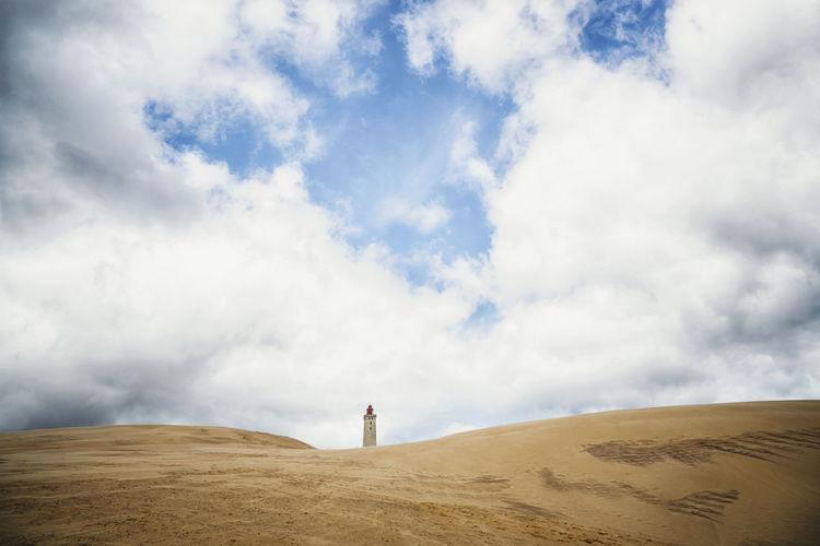 Scenic view of light house in desert against sky