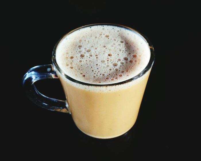 'Teh Tarik' or Milk Tea over dark background. Drink Frothy Drink Refreshment Drinking Glass Food And Drink Black Background No People Tea Teh Tarik Milk Tea Malaysian Food Malaysian Culture