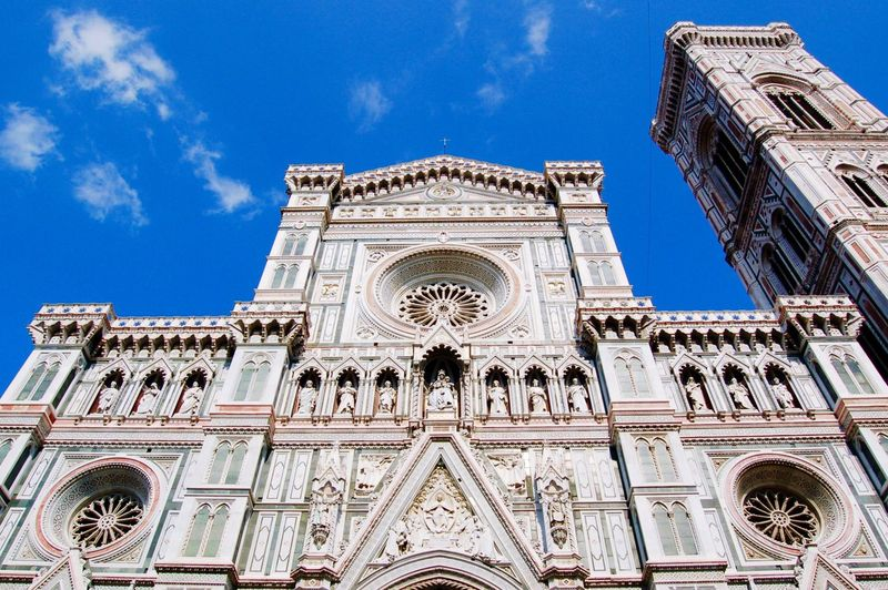 Low Angle View Of Duomo Santa Maria Del Fiore Against Blue Sky