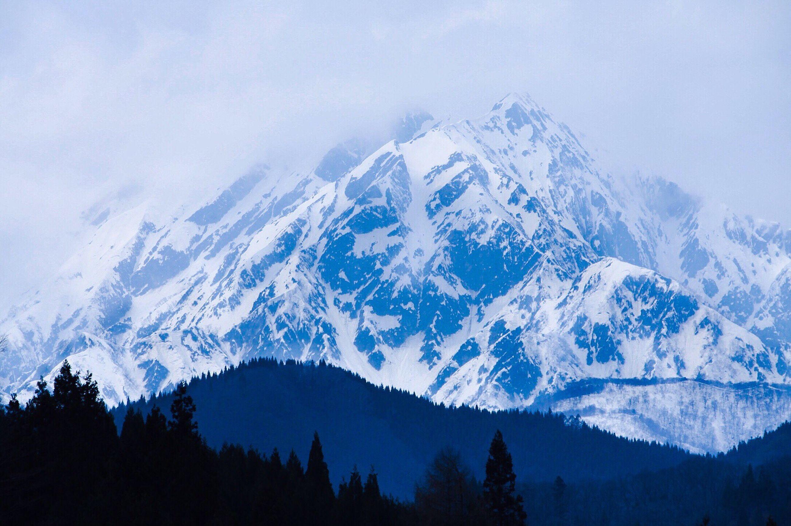 mountain, mountain range, scenics, snow, tranquil scene, tranquility, beauty in nature, winter, snowcapped mountain, cold temperature, nature, sky, tree, weather, idyllic, mountain peak, majestic, landscape, season, non-urban scene
