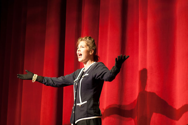 Actress By Red Curtain Performing
