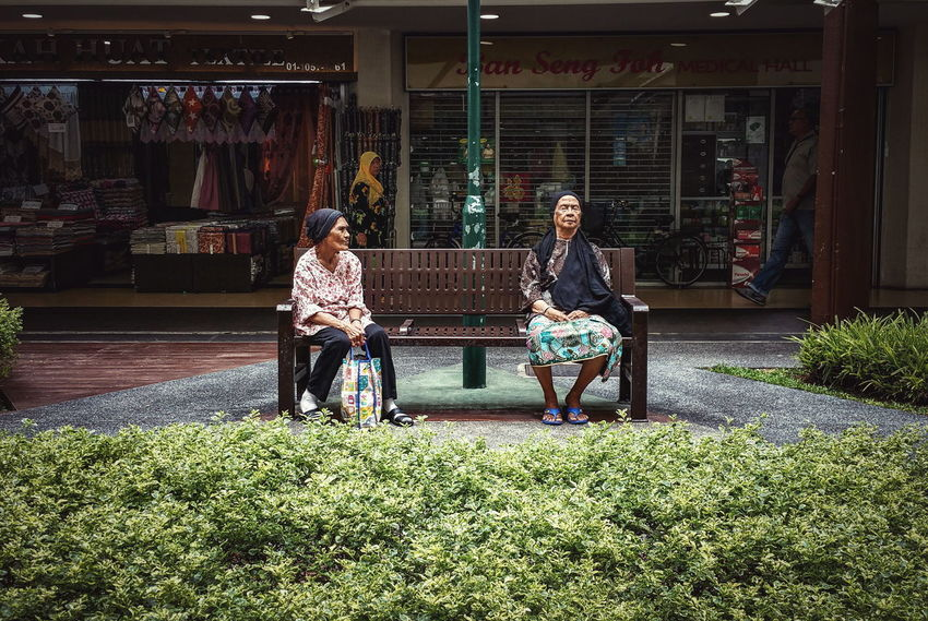 Malay Woman Sitting Sleeping Park Bench Heartland Neighbourhood Void Deck HDB HDB Flats Residential Building Old Friendship Street Life Street Photography Streetphotography Streetphoto_color Everybodystreet Samsung Galaxy Note 4