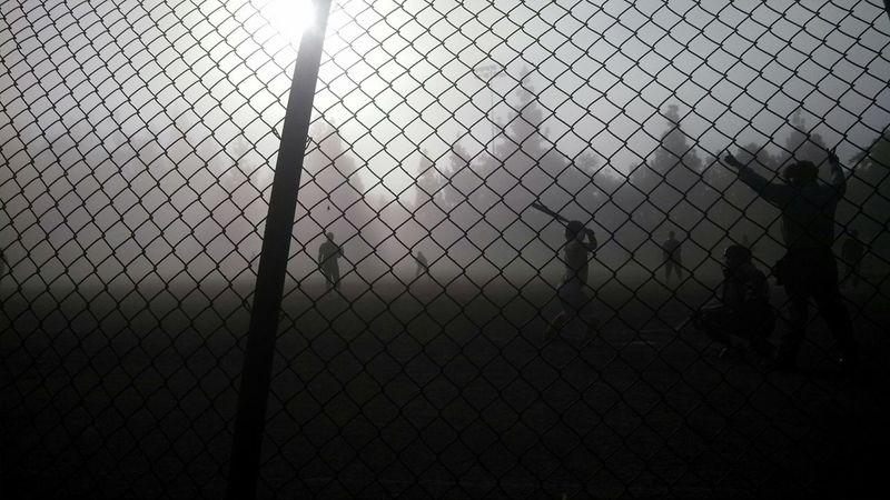 Softball in the fog.