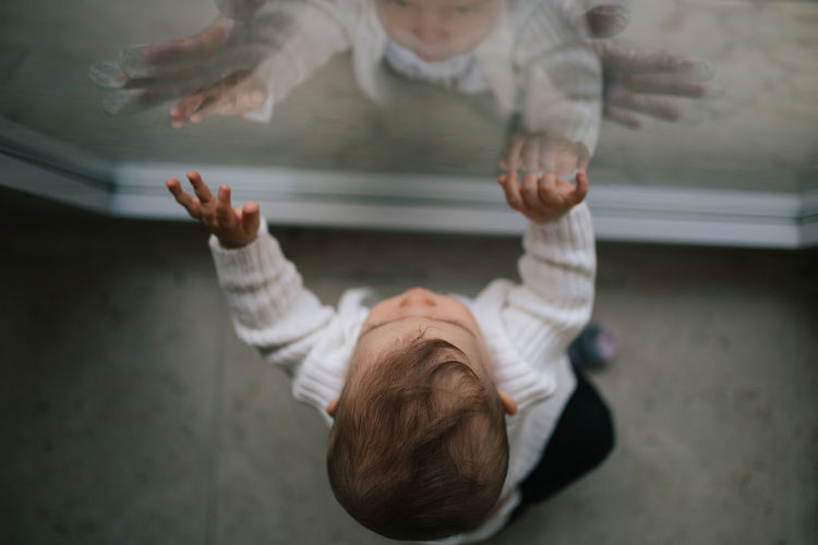 Baby Love Mother Mother & Daughter Mother And Son Motherhood Through The Mirror Babyhood Casual Clothing Child Childhood Directly Above Flooring Full Length High Angle View Indoors  Love ♥ Positive Emotion Real People Through The Window Moms & Dads