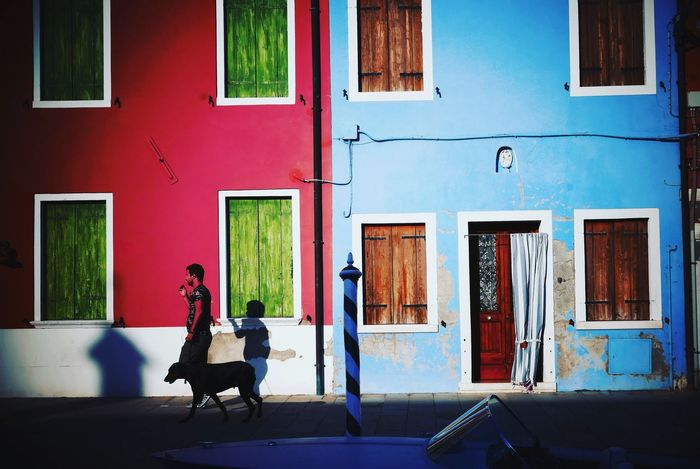 Light and shadows and silhouettes Explore To Create Just Go Shoot Burano, Venice Burano Light And Shadow Silhouette Visuals Of Life What I See Dog People Long Shadows Coloured Houses Walking The Dog Blue House Red Red House Doors And Windows Around The World Shutters EyeEmNewHere