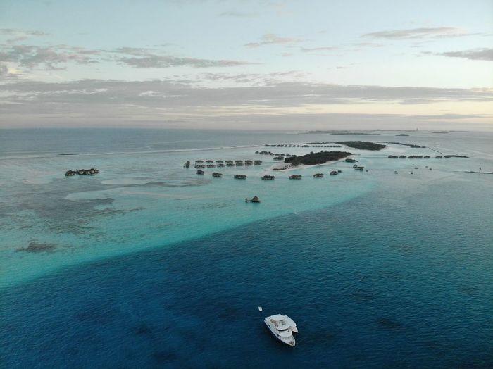 Maldives Drone  Dronephotography Resort Water Nautical Vessel Sea Beach Scuba Diving Sand Aerial View Awe High Angle View Horizon Seascape Lagoon Island