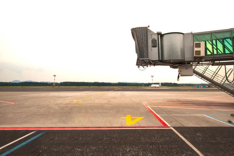 Passenger boarding bridge against sky